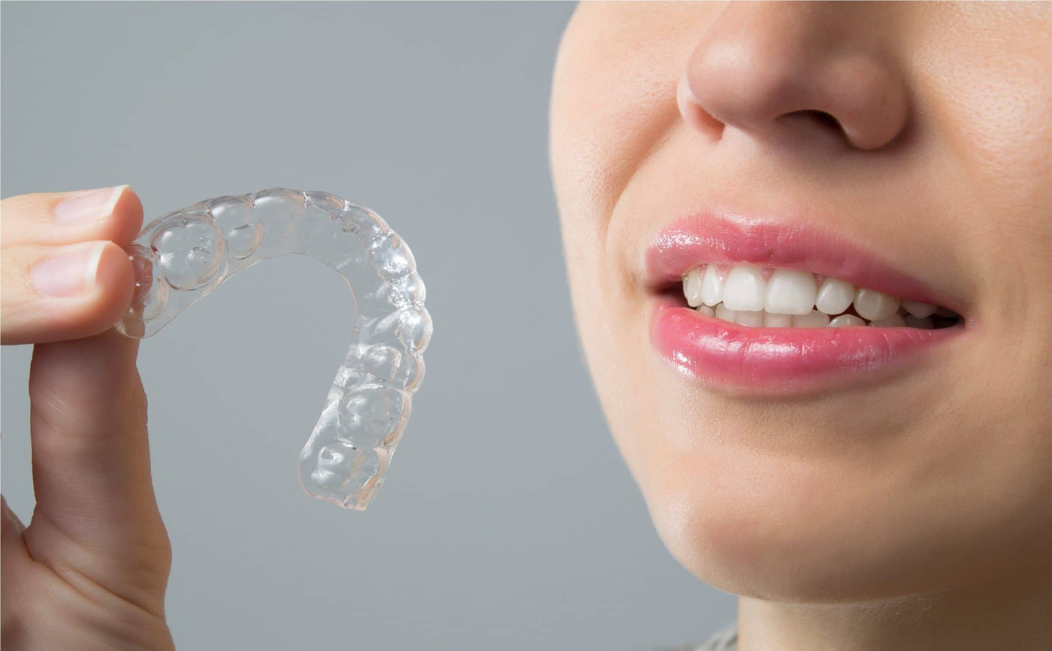 Smiling Woman with silicone trainer. Invisible braces