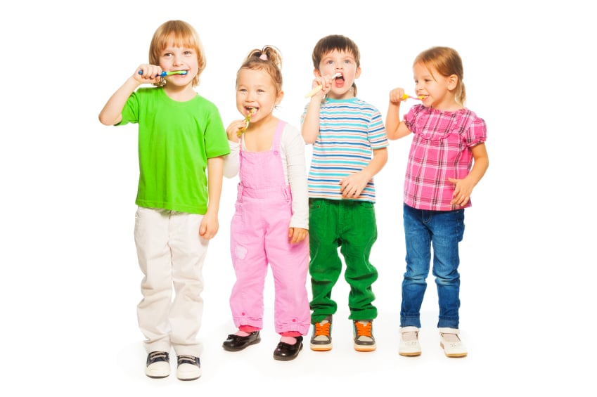 Four kids brushing teeth