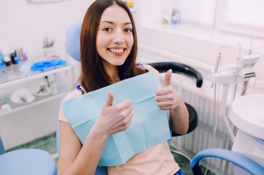 happy young healthy woman treated teeth