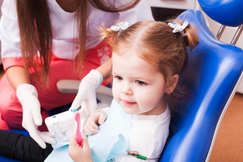 Little girl in a dental office